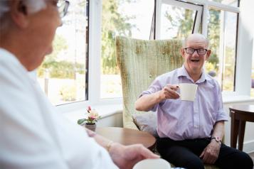 Elderly man enjoying tea  chat