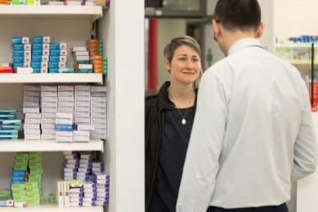 Pharmacist talking to patient